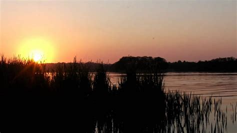 Relaxing Nature Scenes - Sunset over a lake with the